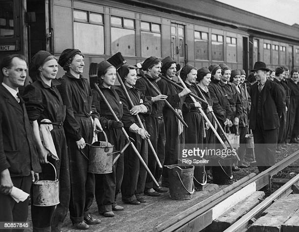 Group of women war workers on parade at a London Underground depot before starting work cleaning carriages, 17th February 1941.