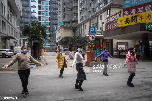 A group of women wear protective masks while exercising on January 27 2020 in Wuhan China As the death toll from the coronavirus reaches 80 in China...