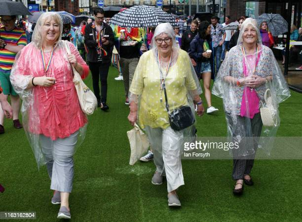 Group of women wear rain covers as they take part in the Newcastle Pride Festival parade on July 20, 2019 in Newcastle upon Tyne, England. To...