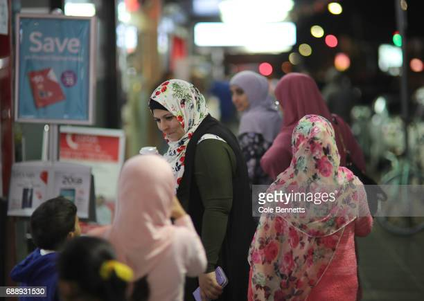 A group of women wearing Hijab make their way through a busy street festival in the southwestern suburb of Lakemba on May 27 2017 in Sydney Australia...