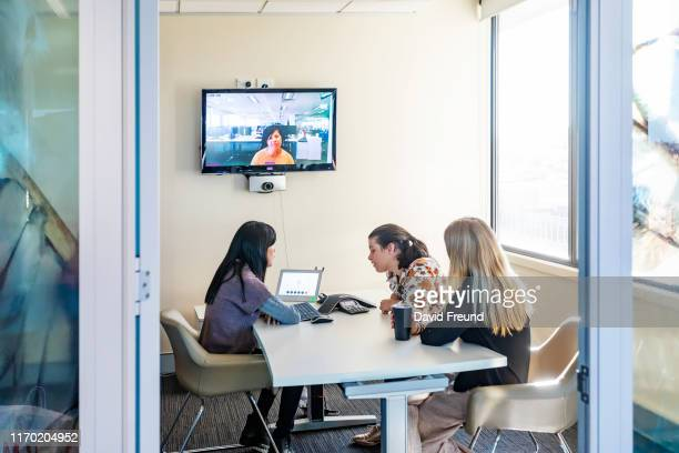 group of women with cerebral palsy having an online meeting - david freund stock pictures, royalty-free photos & images