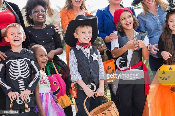 group of women with children in halloween costumes - halloween kids stock photos and pictures