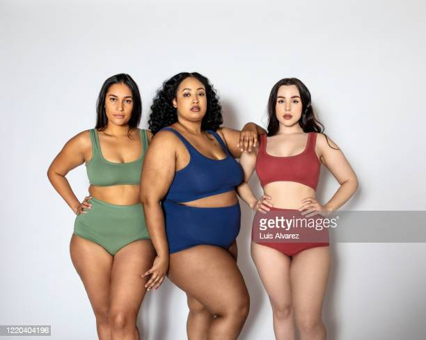 group of women with different body shapes in lingerie - three people stock pictures, royalty-free photos & images