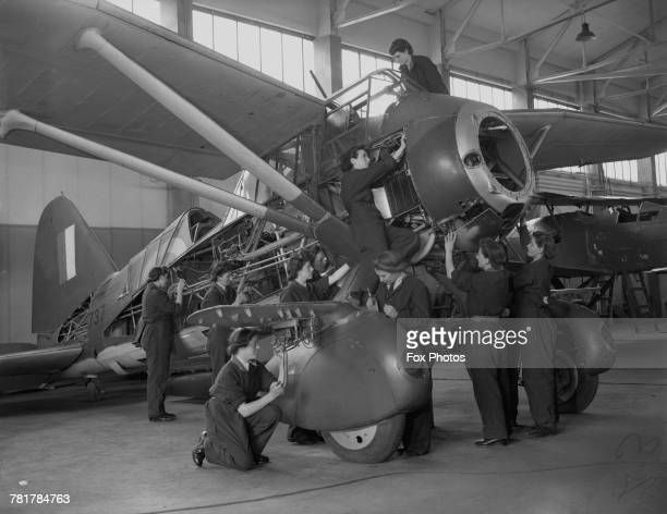 A group of Women's Auxillary Air Force flight riggers and flight mechanics at work on a Westland Lysander army cooperation and liaison aircraft on 20...