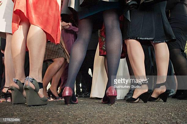 group of women's heels and legs around bride - 囲む ストックフォトと画像
