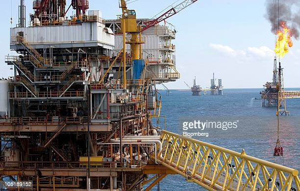 A group of workers are lowered into a ship by crane from the Tonal oil rig owned by Mexican oil company Pemex located 65 miles northeast of Ciudad...