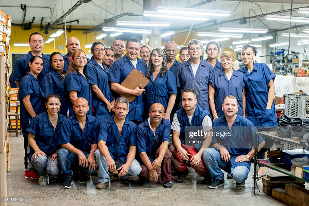 Group of workers at a factory : Stock Photo