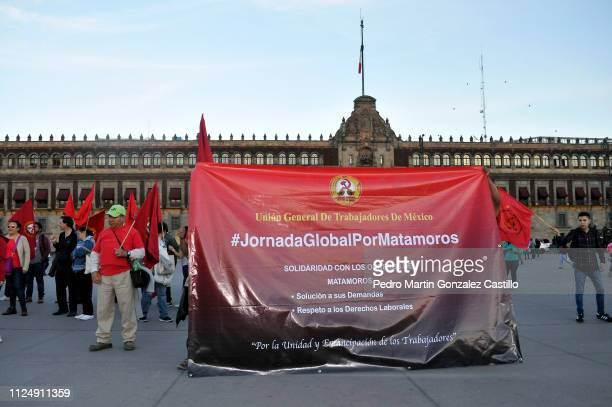 A group of workers from Matomoros Mexican state of northern Tamaulipas display a banner in protest during a journey in favor of the labor rights at...