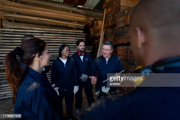 group of workers in training at a wood factory - labor union stock pictures, royalty-free photos & images