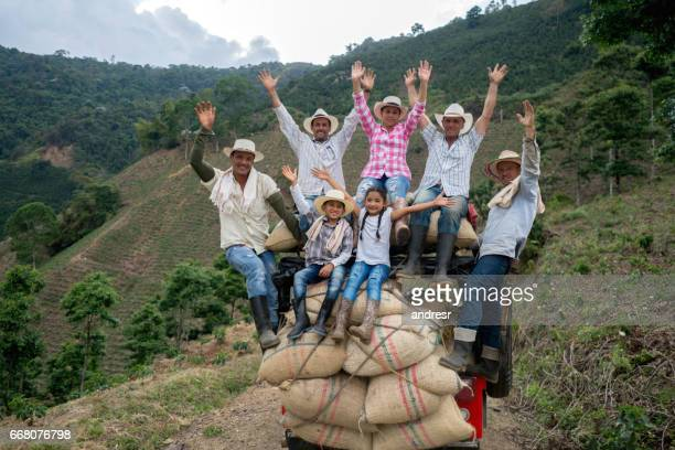 Group of workers transporting coffee on a car at the farm