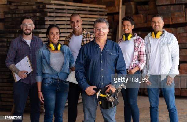 group of workers working at a wood factory - trade union stock pictures, royalty-free photos & images
