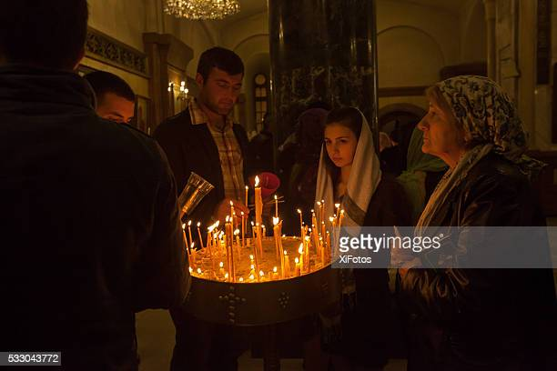 Group of worshipers  at Holy Trinity Cathedral of Tbilisi