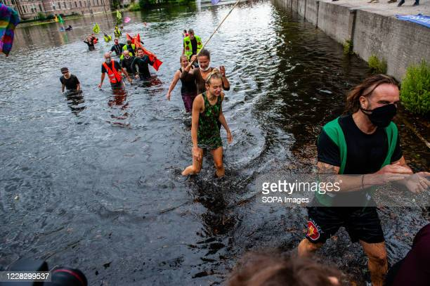 Group of XR activists going out of the water during the demonstration. The climate activist group, Extinction Rebellion in The Netherlands has...
