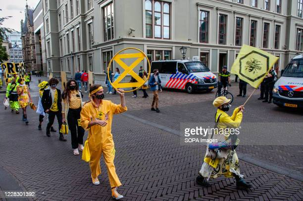 Group of XR models walking past police during the fashion show. An 'XR fashion show' was carried out in front of the House of Representatives in The...