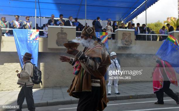 A group of 'Yatiris' take part in civilmilitary parade as Bolivias's President and Vicepresident during the ceremony that marks the 138th anniversary...