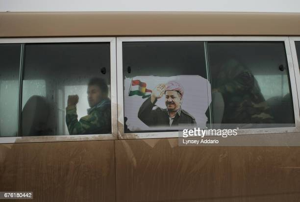 A group of Yazidi Peshmerga sit on a bus at dawn as they head to the frontline in Sinjar where they will fight for ten days from a camp for...