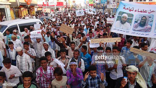 A group of Yemeni people hold banners and shout slogans during a protest against Houthi rebels in Al Hudaydah Yemen on January 28 2015