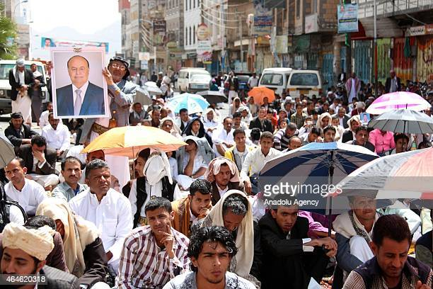 A group of Yemenis listen Friday khutba at Change Square during a friday protest in solidarity with Abd Rabbuh Mansur Hadi forced to resign from...