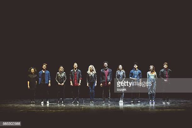 group of young actors on the stage - actor stockfoto's en -beelden
