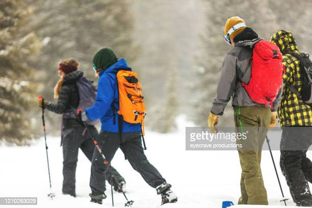 group of young adult caucasian males and females enjoying winter sports activities in cold conditions outdoors series - nordic skiing event stock pictures, royalty-free photos & images
