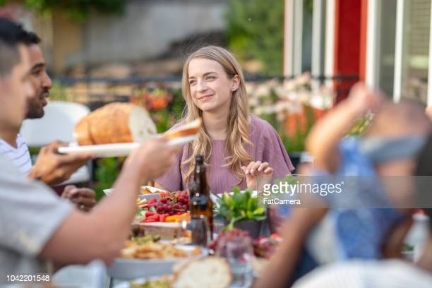 A group of young adult friends dining al fresco on a patio