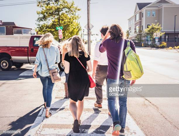 Group of young adults crossing the street