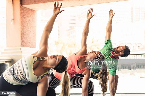 Group of young adults doing yoga