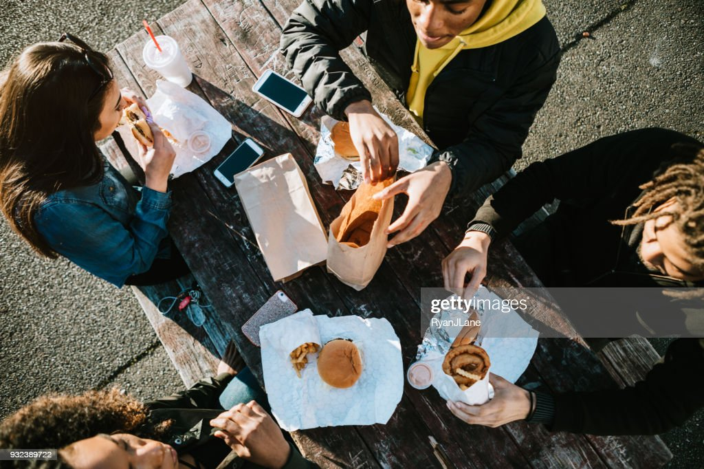 Group of Young Adults Eating Fast Food : Stock Photo
