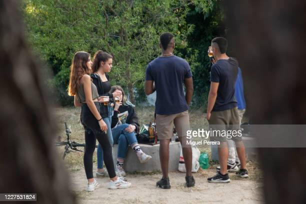 Group of young adults gathers to chat and drink on May 25 at a public park in Majadahonda, Madrid, Spain. Some parts of Spain have entered the...