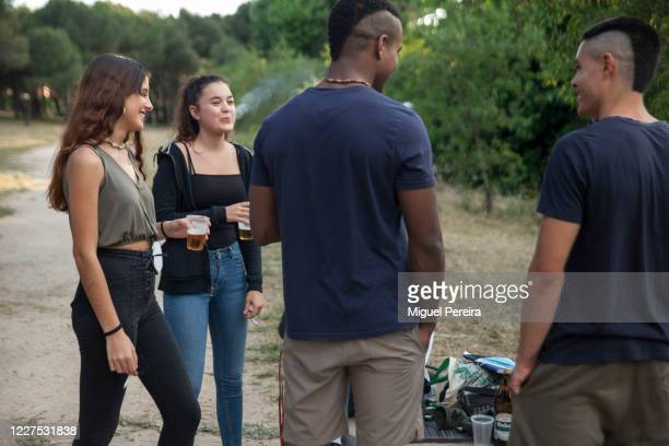 MADRID SPAIN MAY 25 A group of young adults gathers to chat and drink on May 25 at a public park in Majadahonda Madrid Spain Some parts of Spain have...