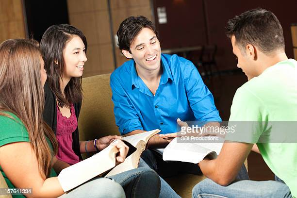 group of young adults having bible study discussion - free bible image stock pictures, royalty-free photos & images