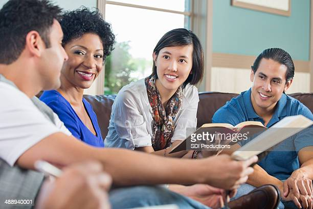 Group of young adults having discussion during bible study