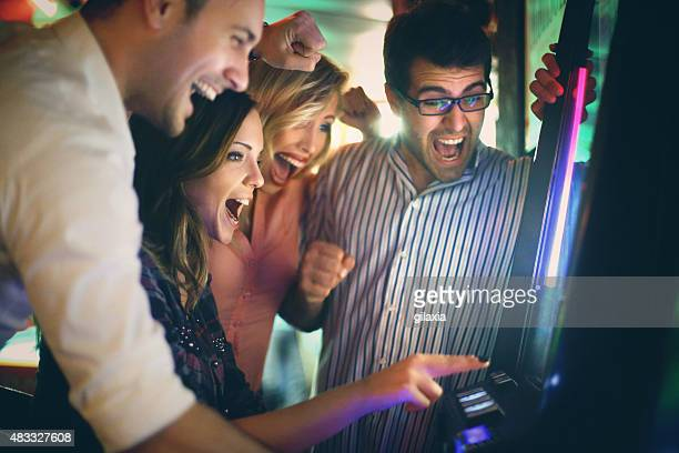 group of young adults having fun in casino. - casino stock pictures, royalty-free photos & images