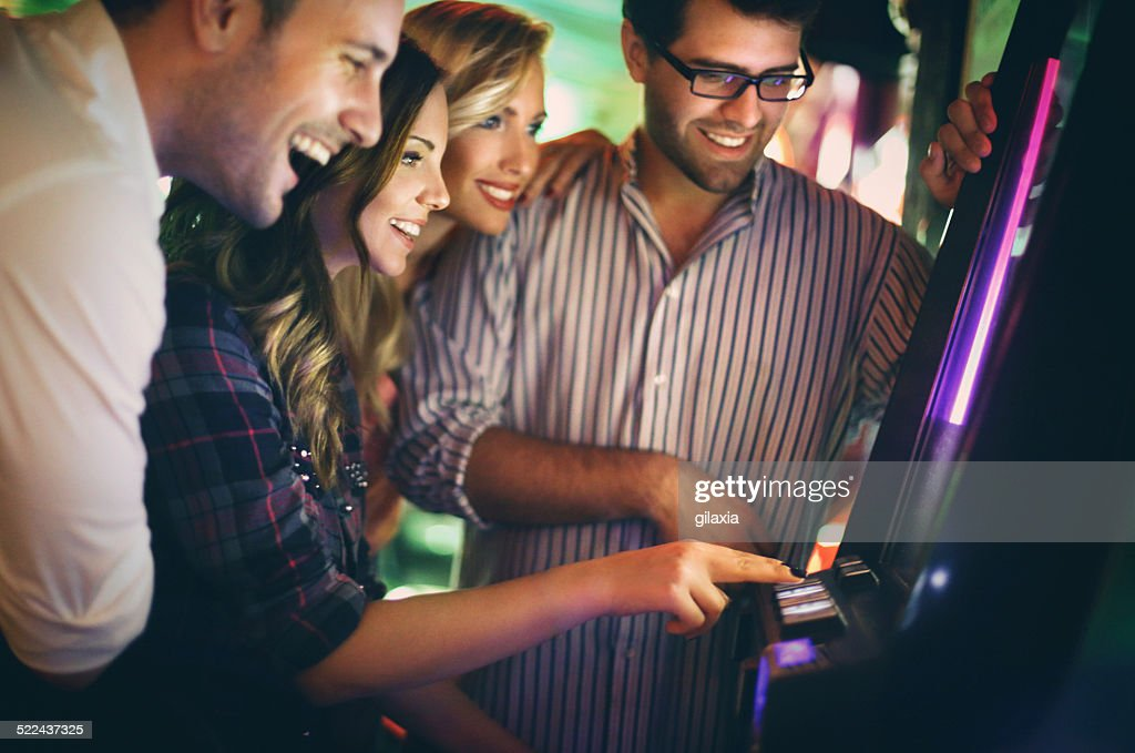Group of young adults having fun in casino. : Stock Photo