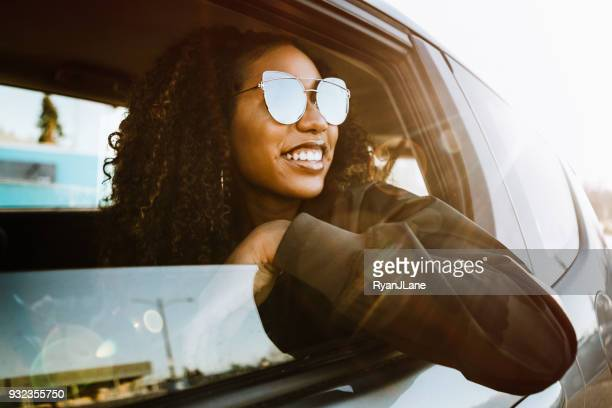 Group of Young Adults Having Fun Riding in Car