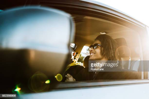 group of young adults having fun riding in car - friends inside car stock photos and pictures