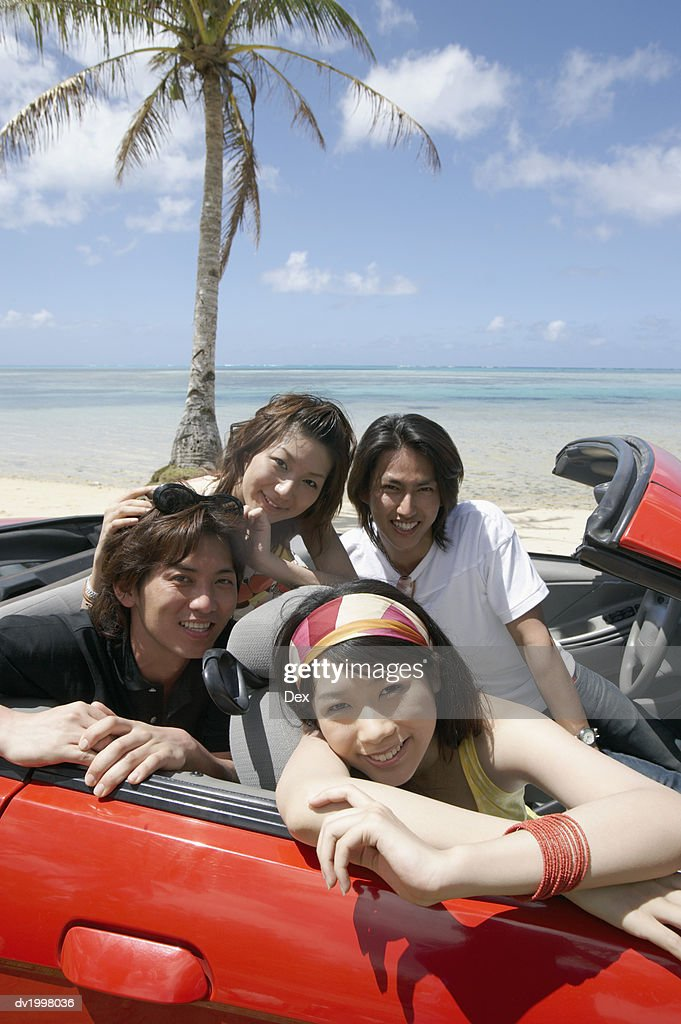 Group of Young Adults in a Convertible by the Beach : Stock Photo