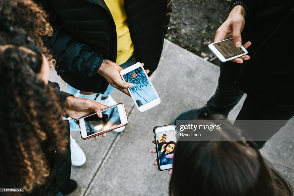 Group of Young Adults Looking at Phone : Stock Photo