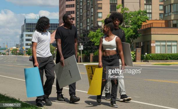 group of young adults protest - anti racism stock pictures, royalty-free photos & images