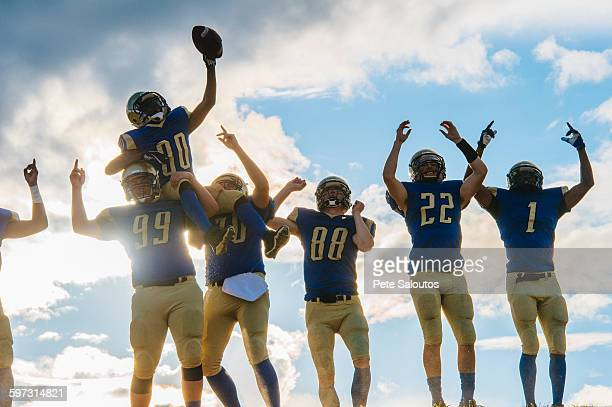 group of young american football players, celebrating - safety american football player stock pictures, royalty-free photos & images