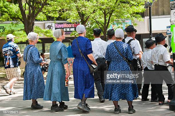 group of young amish ladies - amish woman stock pictures, royalty-free photos & images