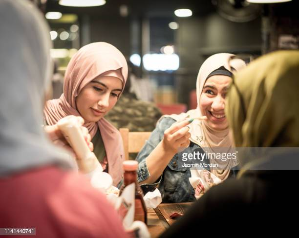 group of young arab girls having a talk - iftar stock pictures, royalty-free photos & images