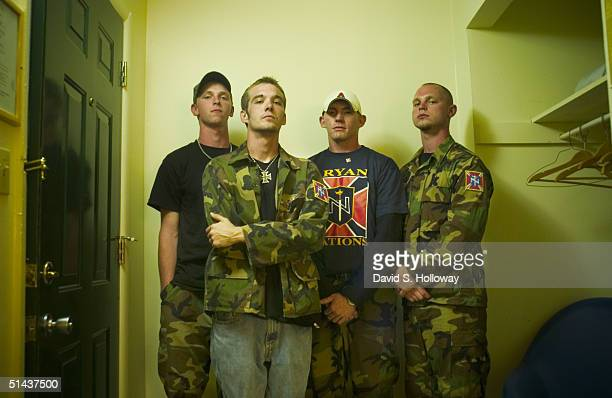 A group of young Aryan Nations members from Georgia led by Christian Identity Minister Johnathan Williams pose for a photograph in a motel room after...