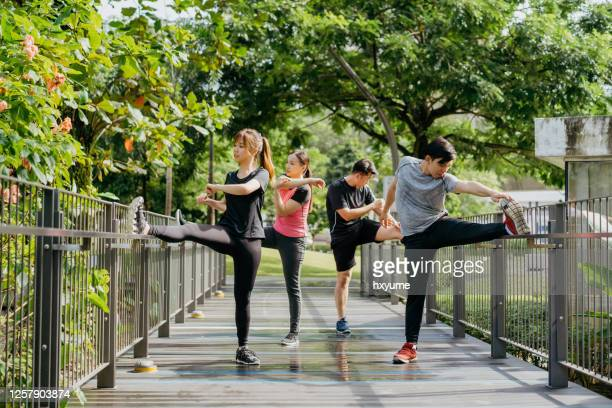 group of young asian stretching and get ready for work out - hong kong stock pictures, royalty-free photos & images
