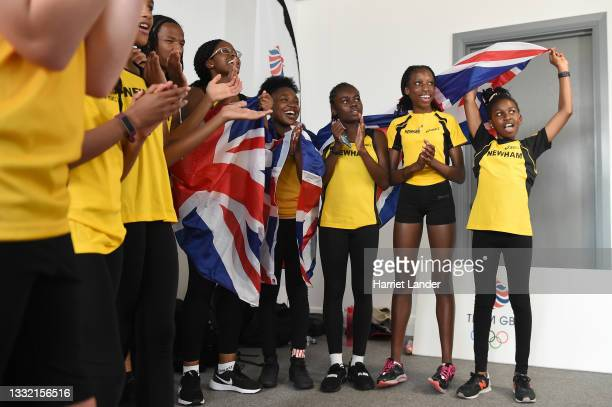 Group of young athletes cheer on Team Great Britain on the TV during Women's 800m Final as the next generation of London young athletes are inspired...
