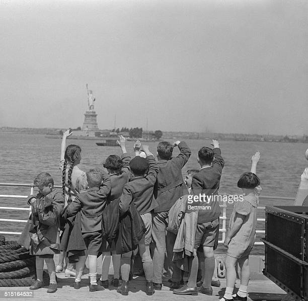 A group of young Austrian immigrants wave to the Statue of Liberty upon their arrival in America aboard the SS Harding The fifty Jewish children who...