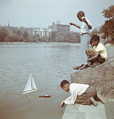 Group of young boys sailing model boats at harlem meer central park picture id1141188487?s=170x170