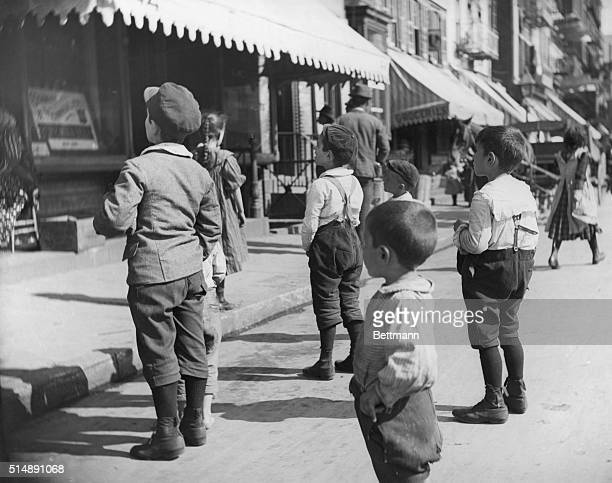 Group of young boys standing together on Mulberry Street Photo 1897