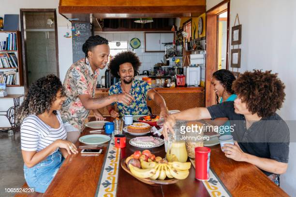 group of young brazilians enjoying breakfast - hostel stock pictures, royalty-free photos & images