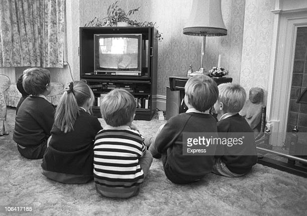 A group of young British children watching television in October 1988
